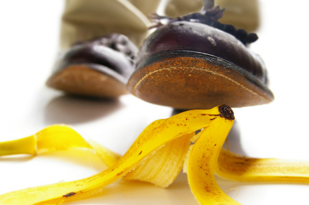 Photo pour Man about to step on a banana peel -- accidental injury concept - image libre de droit