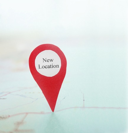 Foto de New Location locator pin on a map - Imagen libre de derechos
