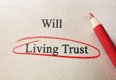 Photo pour Will and Living Trust text with red pencil circle - image libre de droit