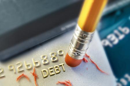 Foto de Pencil erasing credit card debt - Imagen libre de derechos