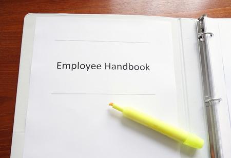 Photo pour Employee Handbook on a desk with highlighter - image libre de droit