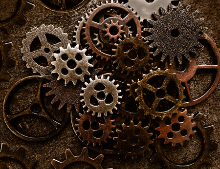 Photo pour Assortment of old metal gears on grunge background - image libre de droit