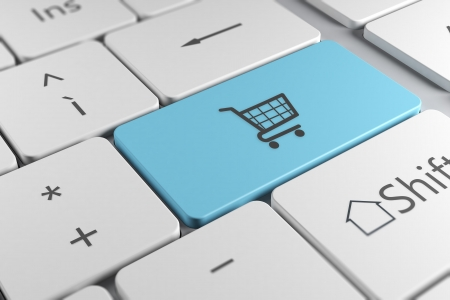 Photo pour Make online purchases directly using a blue button with shopping cart icon in a elegant keyboard - image libre de droit