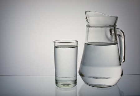 drinking water isolated on gray background