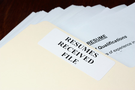 Photo for File with stack of resumes received - Royalty Free Image