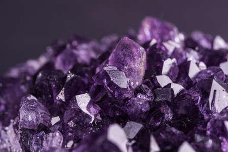 Foto de Amethyst geode on black background. Beautiful natural crystals gemstone. Extreme close up macro shot. - Imagen libre de derechos