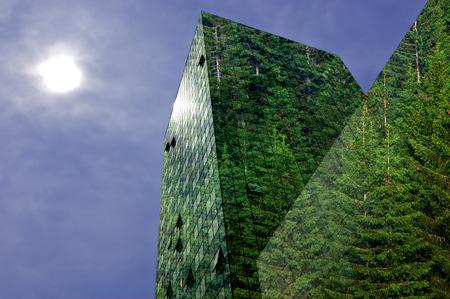 Foto de Green energy in the city: modern building covered with spruce forest - Imagen libre de derechos