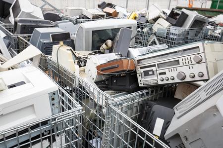 Foto de Electronic devices dump site. E-waste disposal, management, reuse, recycle and recovery concept. Electronic consumerism, globalization, raw material source concept. - Imagen libre de derechos