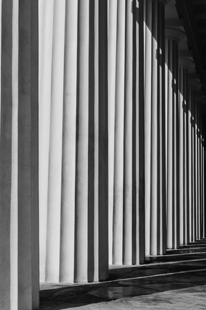 Photo for Abstract structure of black and white antic peristyle with shadows - antic columns, Vienna, Austria - Royalty Free Image