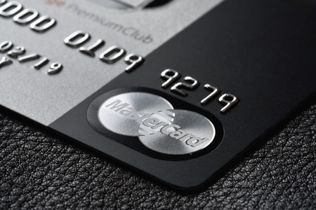 Photo for RUSSIA, MOSCOW - FEB 22, 2015: Premium credit card MasterCard Black Edition on the black leather background. Small depth of field - Royalty Free Image