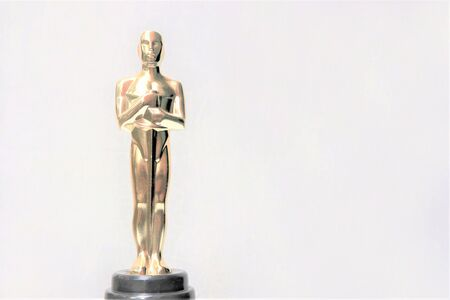 Photo pour The golden statue of Oscar on a white background. Success and victory concept - image libre de droit