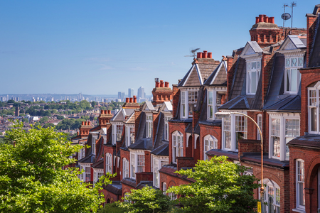 Photo for Brick houses of Muswell Hill and panorama of London with Canary Wharf, London, UK - Royalty Free Image
