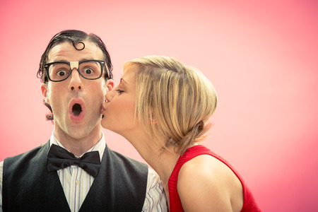 Photo for Nerd man boyfriend kissed by his girlfriend portrait love for valentine day - Royalty Free Image