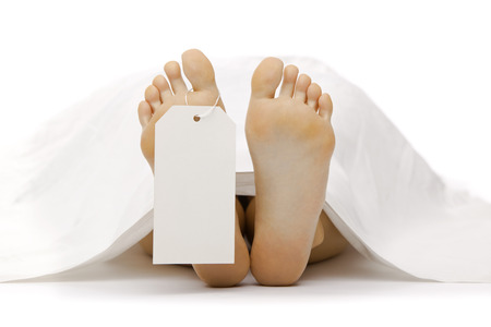 Photo for dead body feet with card autopsy isolated on white - Royalty Free Image