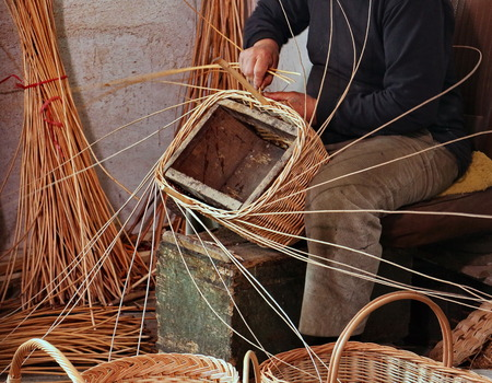 Photo for Expert craftsman while creating a basket - Royalty Free Image