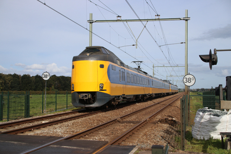 Foto per Intercity train at railroad track between Gouda and Rotterdam at Moordrecht. - Immagine Royalty Free