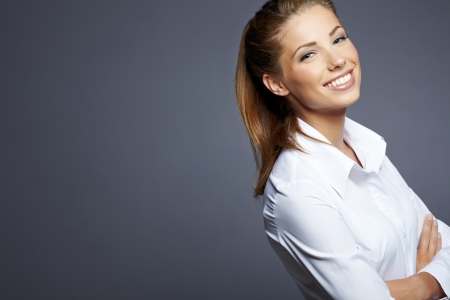 beautiful businesswoman portrait, gray background