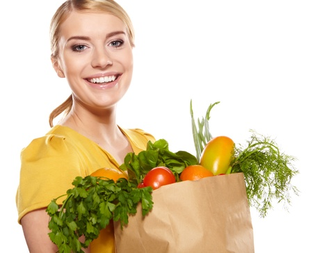 Young woman with a grocery shopping bag  Isolated on white background