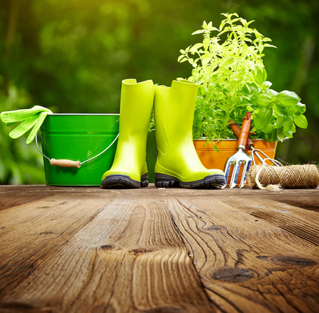Photo pour Outdoor gardening tools on old wood table - image libre de droit