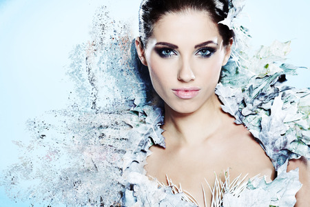 Foto de Young woman in creative image with silver artistic make-up.  - Imagen libre de derechos