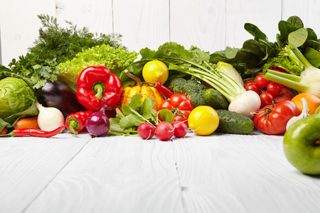 Photo pour frame with fresh organic vegetables and fruits on wooden background - image libre de droit