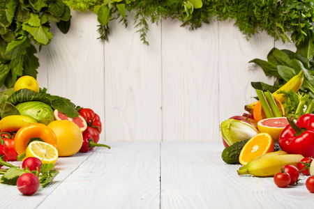 Fruit and vegetable borders Fruit and vegetable borders on wood table