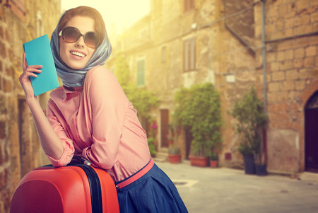 Photo for Elegant woman with a suitcase travel and ticket on street of italian city - Royalty Free Image