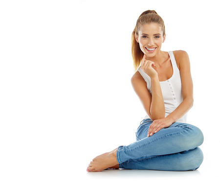 Photo for Young girl in jeans and a white t-shirt - Royalty Free Image