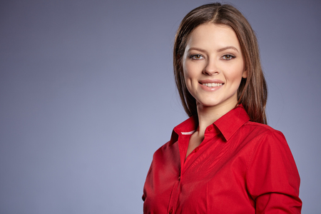 Foto de Smiling young business woman. - Imagen libre de derechos