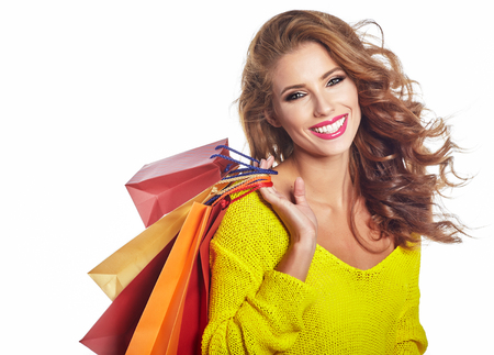 Photo pour Shopping woman holding bags, isolated on white studio background - image libre de droit