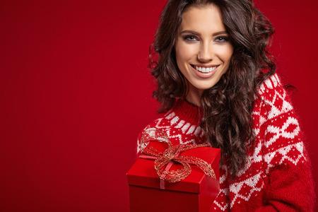 Woman with christmas box gift