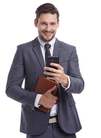 Photo pour busy businessman with phone and folders isolated - image libre de droit