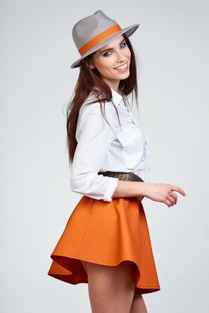 Photo pour Young Woman with spring hat against blue background - image libre de droit