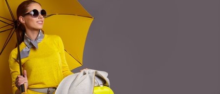 Foto für Fashion  woman with yellow umbrella and suitcase. banner concept - Lizenzfreies Bild