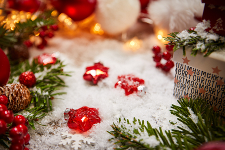 Christmas background with decorations on snow