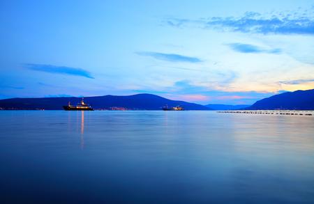 Foto de The Bay of Kotor near Tivat at sunset, Montenegro - Imagen libre de derechos