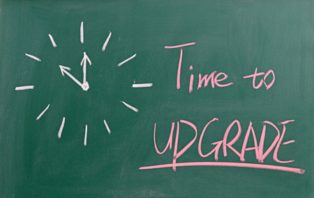 Foto de Time to upgrade written on chalkboard - Imagen libre de derechos
