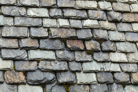 Photo for A roof cover with raw worked slate plates. - Royalty Free Image