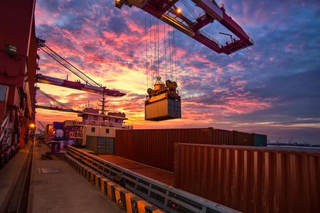 Foto per The freighter docked at the dock for loading and unloading - Immagine Royalty Free