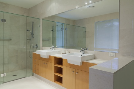 Modern, stylish twin bathroom