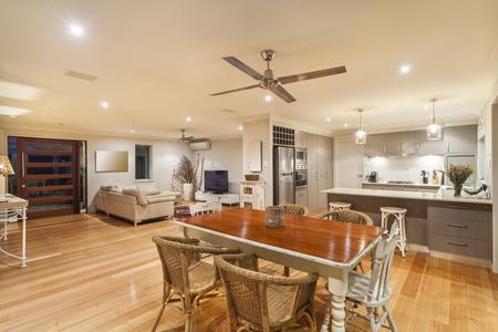Foto de Stylish home interior with kitchen, dining and living room - Imagen libre de derechos