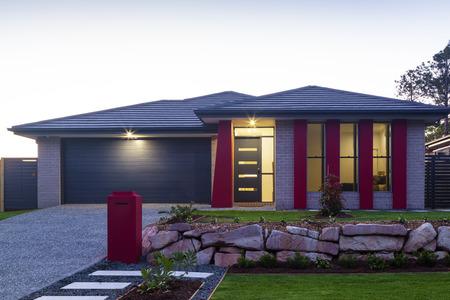 Foto de New stylish modern home exterior at dusk - Imagen libre de derechos