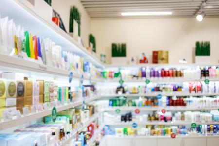 Foto de Various products on shelves at cosmetics store Blurred image. - Imagen libre de derechos