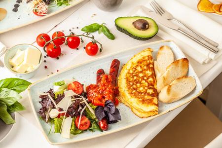 Photo pour The concept of an Italian breakfast. omelette and salad. background image. Copy space, selective focus - image libre de droit