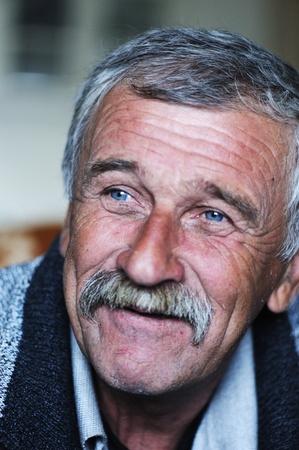 Common elderly positive man with mustache