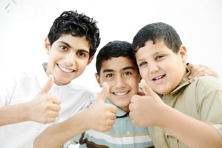 Three boys saying OK with thumbs up