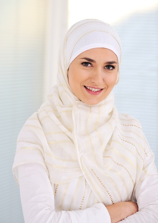 Photo for Young beautiful Muslim woman with traditional but fashionable clothes - Royalty Free Image