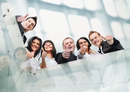 Group of business people at office with thumbs up