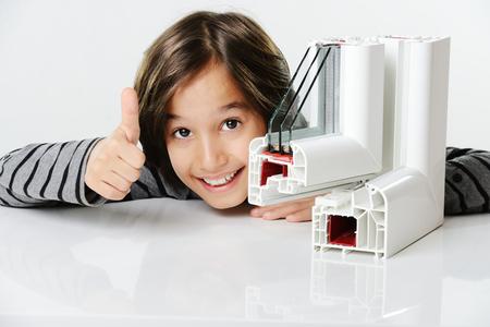 Photo pour Kid holding plastic pvc window profile - image libre de droit