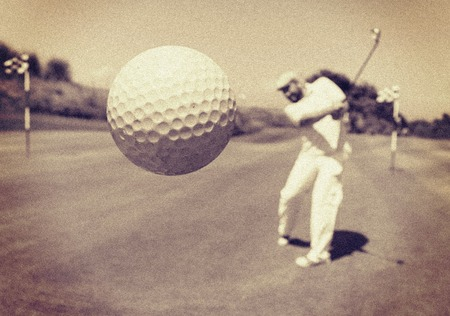 Photo for Man playing golf at club - Royalty Free Image
